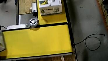 8) 50lb. Boxes 90° Turn at 138 FPM