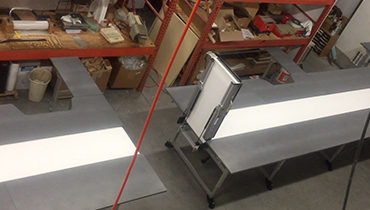 181) Lift gate conveyor for pharmacy work station fulfillment center