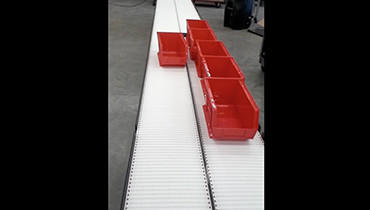 216) pharmacy line conveyor with packaging bins