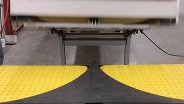 225) split lane lift gate conveyor