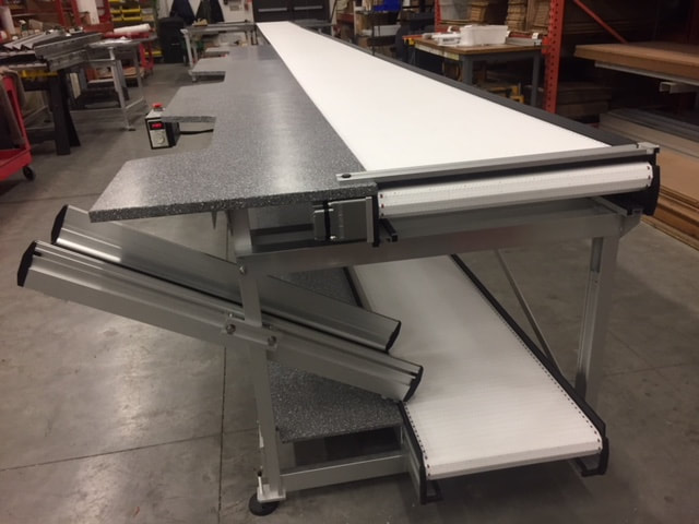 pharmacy conveyor with chute for bins
